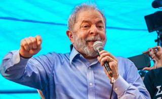 Former Brazilian President Luiz Inacio Lula da Silva speaks to a crowd of 70,000 in the centre of Porto Alegre, Brazil