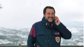 Matteo Salvini pictured wearing a police badge