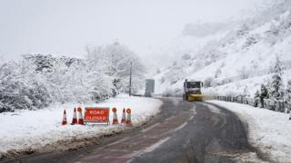 A snowplough clears a closed road on the A470 from Merthyr Tydfil to Brecon, Wales