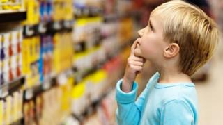 Child making a decision at the supermarket
