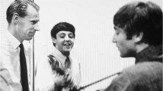 Sir George Martin with Sir Paul McCartney and John Lennon