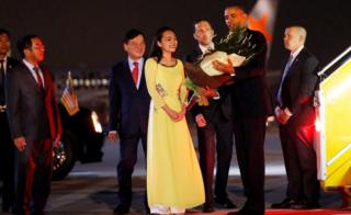 U.S. President Barack Obama receives flowers as he arrives at Noibai International Airport in Hanoi, Vietnam May 22, 2016.