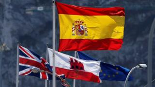 Spanish, British, EU and Gibraltarian flags