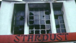 A picture of the burnt out windows of the Stardust nightclub