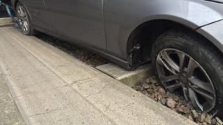 Car stuck on guided busway