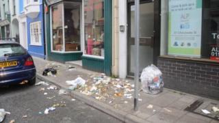 Strewn rubbish on a street in Aberystwyth