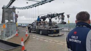 The crew filming on the bridge