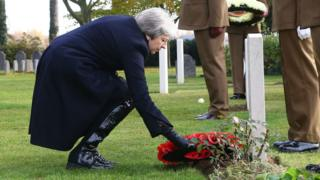 Theresa May lays a wreath at the grave of John Parr