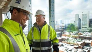 Two men on building site
