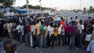 People stand in line to vote in Port-au-Prince