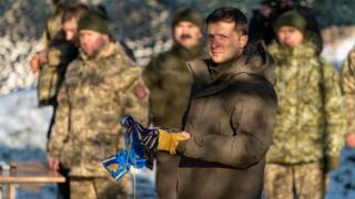 Ukrainian President Volodymyr Zelensky meets with servicemen while visiting the Donetsk region