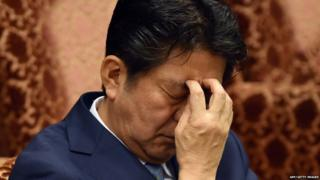 Japan's Prime Minister Shinzo Abe listens to a question by an opposition lawmaker during an Upper House budget committee session at the National Diet in Tokyo on August 10, 2015.