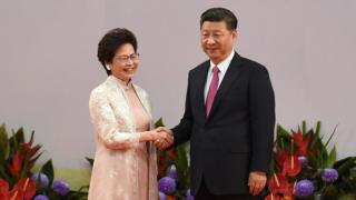 Hong Kong's new Chief Executive Carrie Lam (L) shakes hands with China's President Xi Jinping (R) after being sworn in as the territory's new leader at the Hong Kong Convention and Exhibition Centre in Hong Kong on 1 July, 2017.