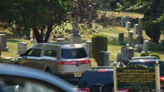 Hearse passes through the gates into Fairview cemetery, 3 Aug