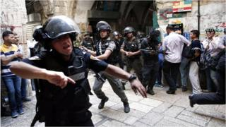 Israeli police use stun grenades as they start to disperse Palestinian demonstrators in Jerusalem's Old City