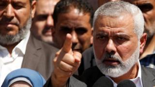 هنية أعلن نبأ القبض على المشتبه به في مؤتمر صحفي