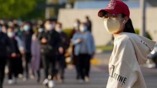 Woman wearing mask in Beijing - 23 April