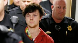 Ethan Couch is led by sheriff deputies after a juvenile court for a hearing in Fort Worth, Texas