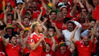 Wales fans celebrate Aaron Ramsey scoring in the Euro 2016 pool win over Russia
