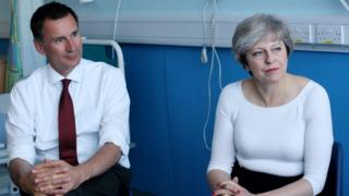 British Prime Minister Theresa May and British Secretary of State for Health Jeremy Hunt
