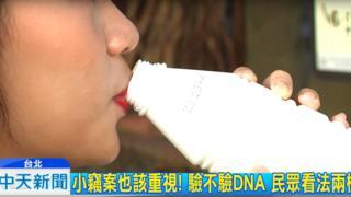 A woman drinking a yoghurt drink