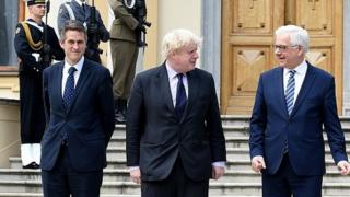 Gavin Williamson (left) and Boris Johnson (middle) on recent visit to Poland