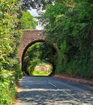 Houses seen through a bridge arch