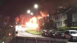 Bins were set alight and used as a burning barricade during trouble in Larne