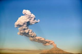 The Popocatepetl Volcano spews ash and smoke, as seen from Puebla, central Mexico