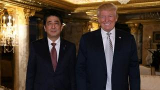 Japan's Prime Minister Shinzo Abe meets with US President-elect Donald Trump