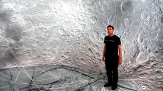 Artist Luke Jerram inside the moon balloon