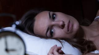 Woman struggling to sleep