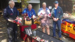Members of Echills Wood Railway with the damaged gnomes