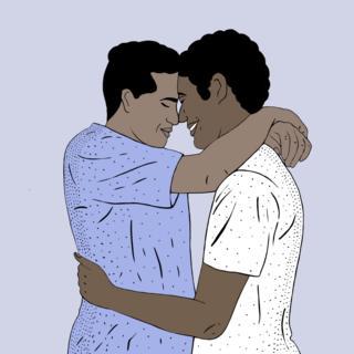 Young men embracing