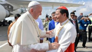 Francis arrives in Myanmar
