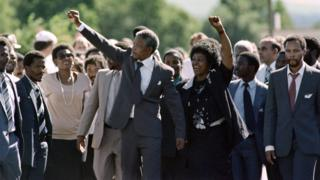 Former South African President Nelson Mandela (centre) with his wife Winnie following his release from Victor Verster prison on 11 February 1990