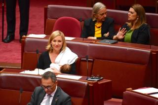 Senator Larissa Waters breastfeeds her daughter Alia Joy in Australian parliament.