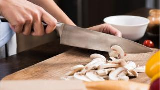 Woman chopping mushrooms