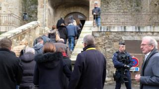 Mourners arrive at the Saint Etienne Church in Trebes in southwest France on March 25, 2018,