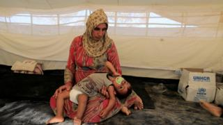 A displaced woman and baby near Raqqa, Syria, 18 August