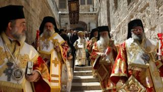 Greek Orthodox Patriarch of Jerusalem Theophilos III (C) leads the Easter Sunday traditional procession toward the Church of the Holy Sepulchre in Jerusalem's Old City