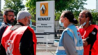 Employees of French carmaker Renault gather near one of its Paris sites to protest