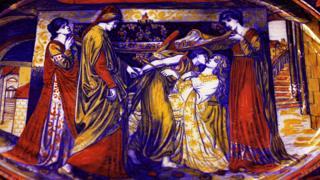 """Plato esmaltado de loza que representa 'El sueño de Dante"""" por Dante Rossetti. Muestra a Dante guiado por la figura angelical del amor, al lecho de muerte de su amada Beatrice."""