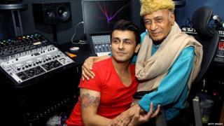 Khayyam (R) and playback singer Sonu Nigam pose during the song recording for the upcoming film 'Gulam Bandhu' in Mumbai on August 31, 2015