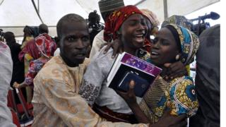 A Chibok girl celebrates with family members during an church service held in Abuja, Nigeria - Sunday 16 October 2016