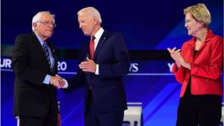 Democratic presidential hopefuls US Senator for Vermont Bernie Sanders (R) greets Former US Vice President Joseph R. Biden Jr. (L) as Massachusetts Senator Elizabeth Warren looks on during the third Democratic primary debate