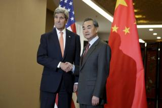 US Secretary of State John Kerry (L) and Chinese Foreign Minister Wang Yi shake hands before their bilateral meeting at the Ministry of Foreign Affairs in Beijing 27 January 2016