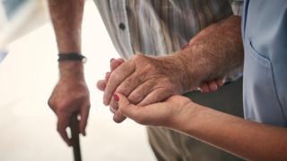 Elderly man receiving care