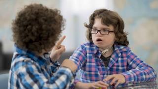 Two deaf children talking in sign language