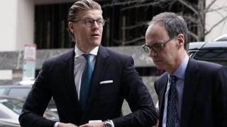 Attorney Alex van der Zwaan (L), who formerly worked for the Skadden Arps law firm, arrives at a U.S. District Courthouse for his sentencing April 3, 2018 in Washington, DC.